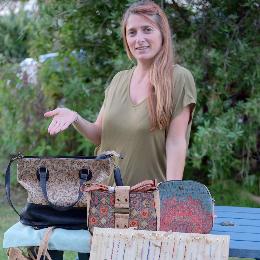 Melanie C. , owner and founder of Secret Fern creations showing her creations